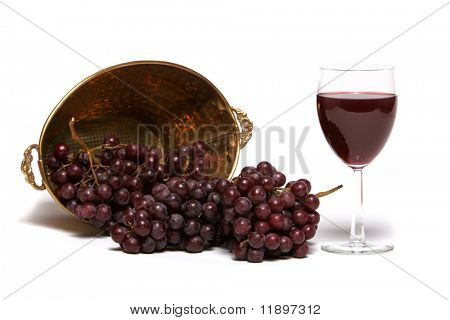 Red grapes and a glass of red wine