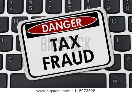 Online Tax Fraud, Computer Keyboard And Black And White Danger Sign