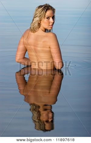 Back of a woman in water