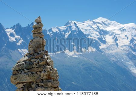 Cairn, at background can be seen the Mont Blanc Peak, Mont Blanc Massif, Alps, Chamonix, France