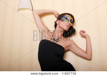 Sexy brunette woman wearing mask