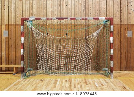 Old and worn soccer goalpost in old gymhall