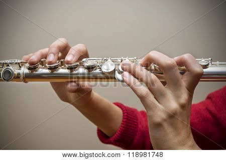 Woman Holding Flute