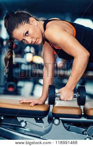 Female Athlete Exercising In The Gym