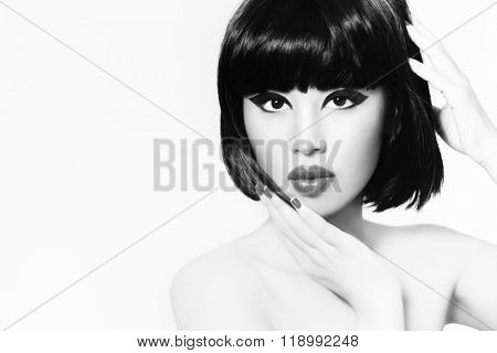 Black and white portrait of young beautiful asian girl with stylish bob haircut touching her face