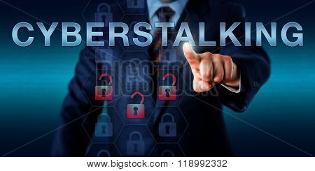 Forensic investigator is pushing CYBERSTALKING on a touch screen interface. Technology concept for the continuous process cyberbullying monitoring identity theft threat and online vandalism. poster