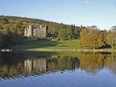 castlewellan castle ireland reflecting onto the lake in the evening sun poster