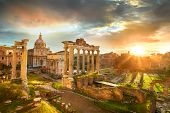 Famous Ruins of Roman Forum in Rome Italy during sunrise. poster