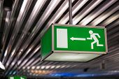 Emergency exit sign at an international airport poster