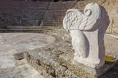 Roman theatre of Medellin Spain. Winged lion sculpture in orchestra side poster