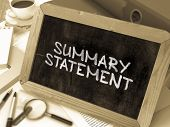 Summary Statement Handwritten by White Chalk on Blackboard. Composition with Small Chalkboard on Background of Working Table with Office Folders, Stationery, Reports. Blurred, Toned Image. 3D Render. poster