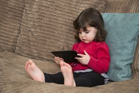 Toddler watching cartoon on a tablet screen