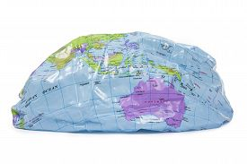Partly deflated word globe - global warming concept
