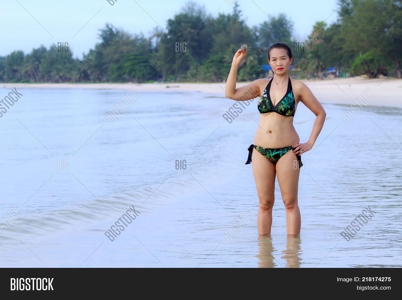 24ed37e3f2e Woman show shape sexy with bikini on beach at Thung Wua Lan Beach Chumphon  Province Thailand