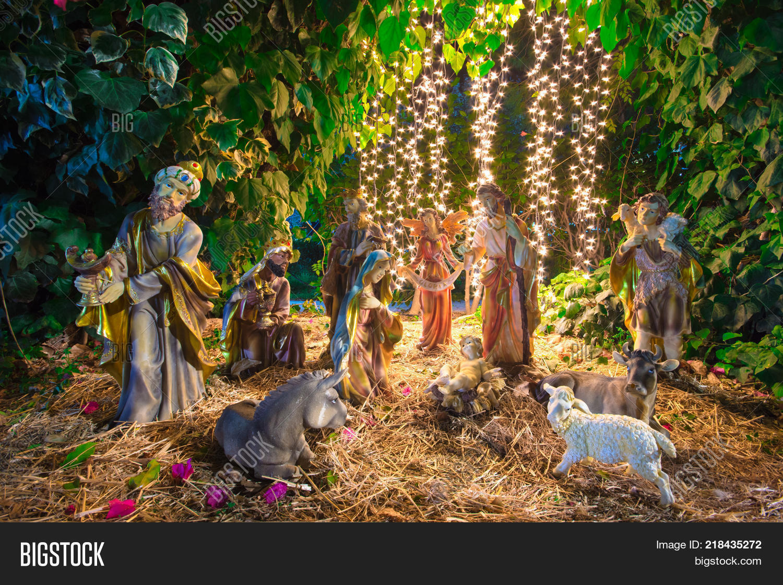 christmas manger scene with figurines including jesus mary joseph sheep magi and