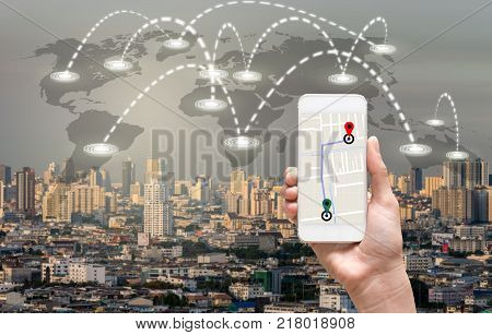 female hands holding a smart phone showing part of navigator map over screen on connection line over the photo blurred of cityscape with world map which dicut each elements Navigation concept, 3D illustration