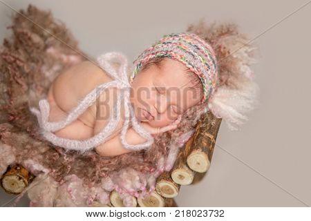 Newborn girl sleeping on small crib