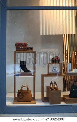 Shop window with shoes, bag and accessories.