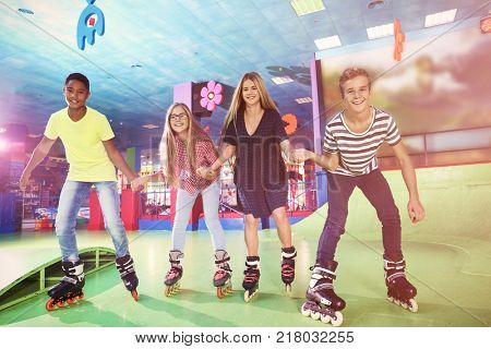 Group of teenagers at roller skating rink
