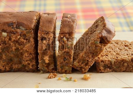 Typical Dutch spice bread with Succade, ginger, cinnamon, nutmeg and cloves made in the province of Friesland sliced close up