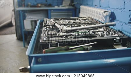 A set of tools for repair - screwdriver, voltmeter, wrenches - car service, close up view