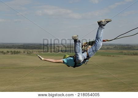 Belarus Gomel May 06 2017.Jumping with a rope.Extreme man jumping from a huge height.Jumping with a rope.Flight down on the rope.Engage in ropejumping.Dangerous hobbies
