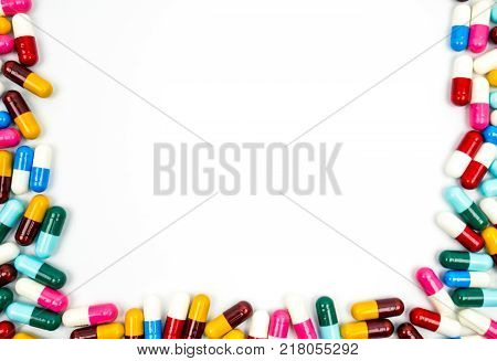 Colorful of antibiotic capsules pills frame isolated on white background with copy space. Drug resistance concept. Antibiotics drug use with reasonable and global healthcare concept.