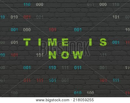Time concept: Painted green text Time is Now on Black Brick wall background with Binary Code