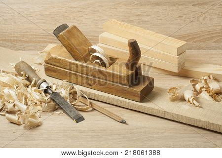Carpentry concept.Joiner carpenter workplace. Construction tools and pencil on wooden table with sawdust. Copy space for text.