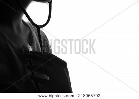 silhouette of a young man listening and feeling to circle space with a stethoscope. Love feel and care about world concept