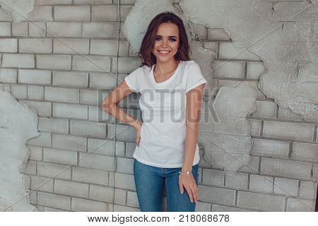 Sexy woman in a white t-shirt. Mock up.