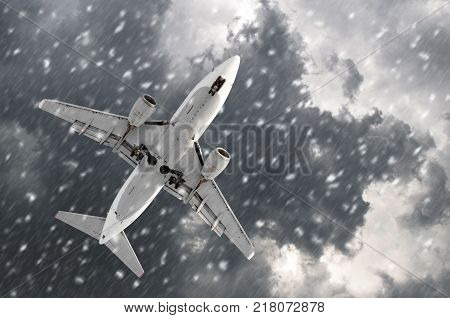 Airplane approaching on a landing in bad snow weather