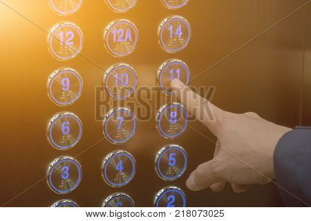 Using hands press the elevator up and keypad elevator