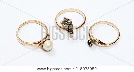Three golden rings isolated on a white background