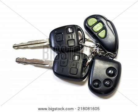 Two car keys with remote on white background