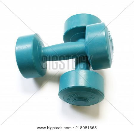the green dumbells isolated on white background
