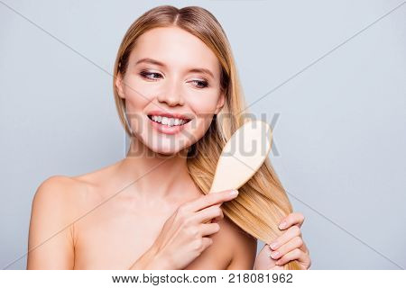 Close Up Portrait Of Happy Attractive Woman, She Is Brushing Her Silky Smooth Hair After Using Nouri