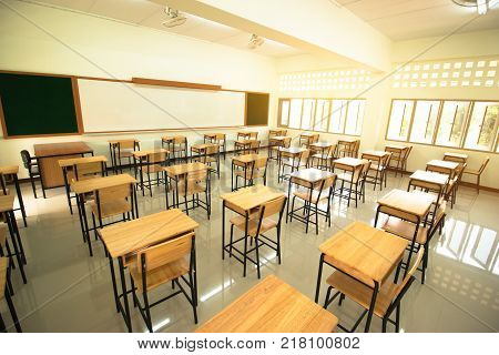 Lecture room or School empty classroom with desks and chair iron wood in high school thailand interior of secondary education vintage tone educational concept