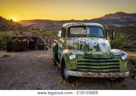 COOL SPRINGS, ARIZONA, USA - MAY 19, 2016: Car wrecks in the Mojave desert on historic route 66 at sunset.