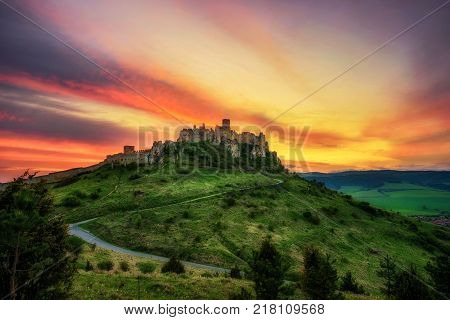 Dramatic sunset over the ruins of Spis Castle in Slovakia.  Spis Castle is a national monument and one of the biggest European castles by area.