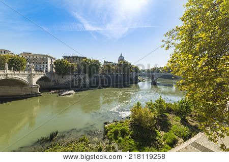 Sun shining over Tiber river in Rome Italy