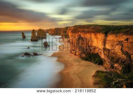 Sunset over The Twelve Apostles along the famous Great Ocean Road in Victoria, Australia, near Port Campbell. Long exposure.