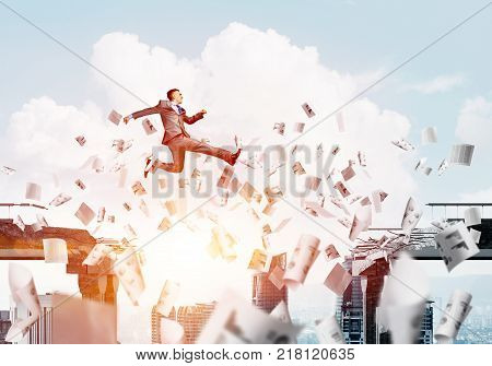 Businessman jumping over gap with flying paper documents in concrete bridge as symbol of overcoming challenges. Cloudly with sunlight skyscape on background. 3D rendering. poster