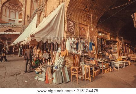 ISFAHAN, IRAN - OCT 14, 2017: Marketplace with sellers of good stuff in walls of building of Eastern Bazaar on October 14, 2017. The 3rd largest city of Iran Isfahan is example of Iranian Islamic culture