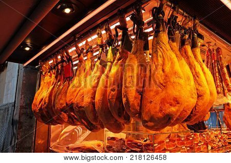 Catalan jamon. Fresh jamon weighs in the Boqueria market in Barcelona.