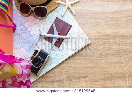 Planing Summer traveling passport with old suitcase camera vintage and Fashion woman swimsuit Bikini fish star sun glasses hat airplane. Travel in the holiday Top view blue wooden and copy space. Summer and Travel Concept.