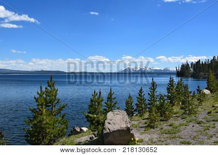 Yellowstone Lake is the largest body of water in Yellowstone National Park. The lake is 7,732 feet above sea level with 110 miles of shoreline.