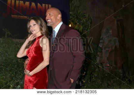 LOS ANGELES - DEC 11:  Lauren Hashian, Dwayne Johnson at the