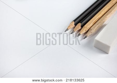 close up portrait of sharp pencil with eraser on blank paper