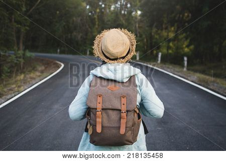 Happy hipster old women backpack traveling on the road relax time and holiday color vintage style selective and soft focus